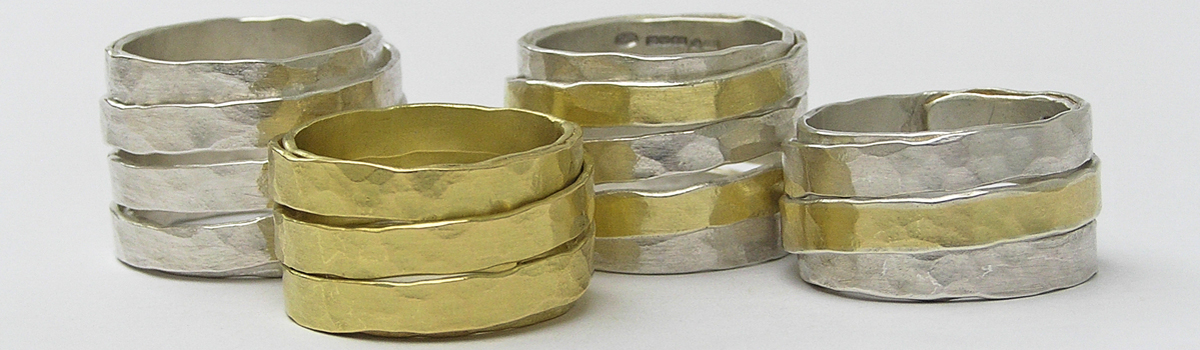 Wrapped rings in silver and gold header